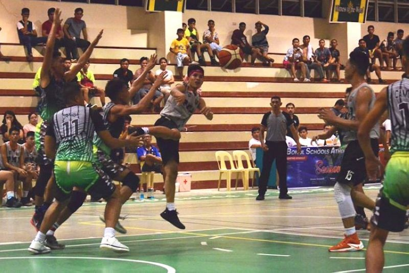 HELP.  A player from PMI Colleges tries to look for an open teammate against  Trinidad Municipal College. (Contributed photo)