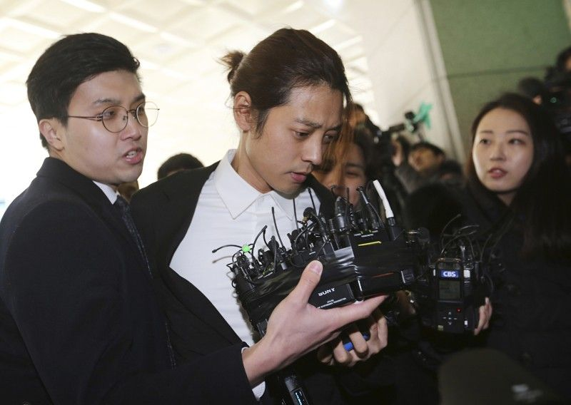 SOUTH KOREA. In this March 14, 2019, file photo, K-pop singer Jung Joon-young, center, arrives at the Seoul Metropolitan Police Agency in Seoul, South Korea. A South Korean court has found two K-pop stars guilty of illicit sexual relations with a woman who was unable to resist and sentenced them to up to six years in prison. The Seoul Central District Court said singer-songwriter Jung received a six-year prison term. (AP)