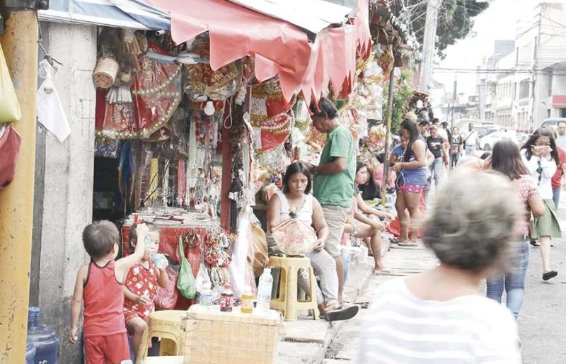 VENDORS' RELOCATION. Priests of the Basilica Minore del Sto.Niño de Cebu are asking permission to clear D. Jakosalem St. (SunStar photo/Amper Campaña)