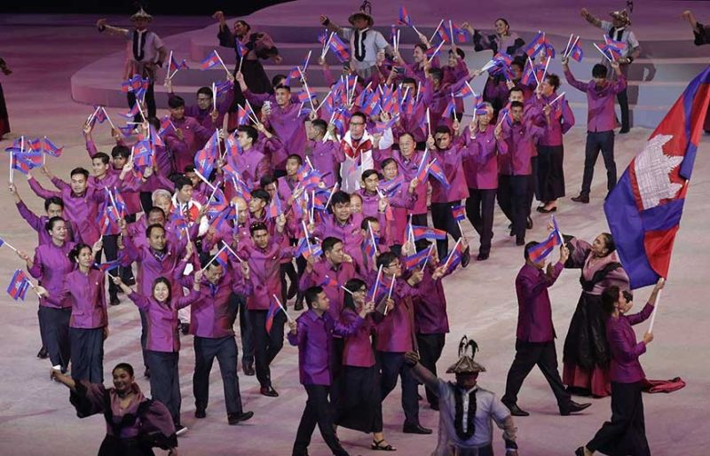 BRUNEI AND CAMBODIA IN FULL FORCE. The national teams of Brunei (top) and Cambodia (left) hold flags during the opening ceremony of the 30th Southeast Asian Games. (AP photo/Aaron Favila)