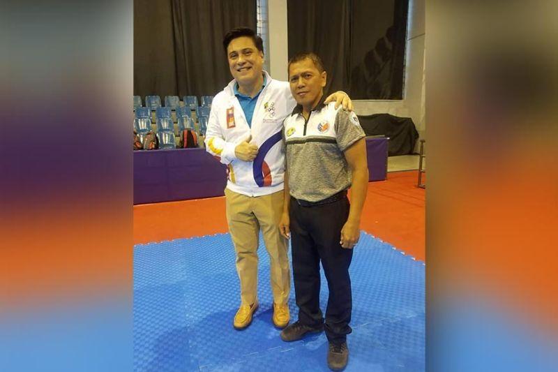 MANILA. SEA Games arnis referee Leo Villegas of Cagayan de Oro with Senator and true-blue arnisador Juan Miguel