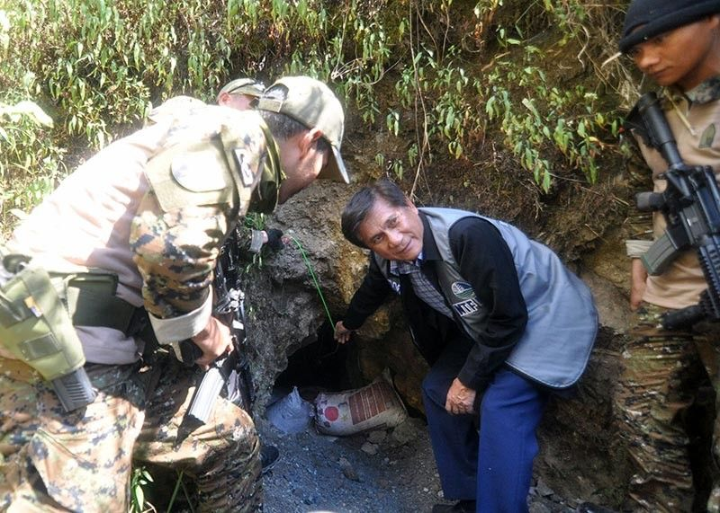 SMALL-SCALE TUNNEL. Environment and Natural Resources Secretary Roy Cimatu along with military personnel inspects one of the mine tunnels at the Philippine Military Academy reservation during his visit in Baguio City in 2018. Baguio representative Mark Go recently filed House Bill 5619 which seeks to declare the city a mining-free zone in response to the growing geohazards and environmental threats in the city. (SSB file photo)