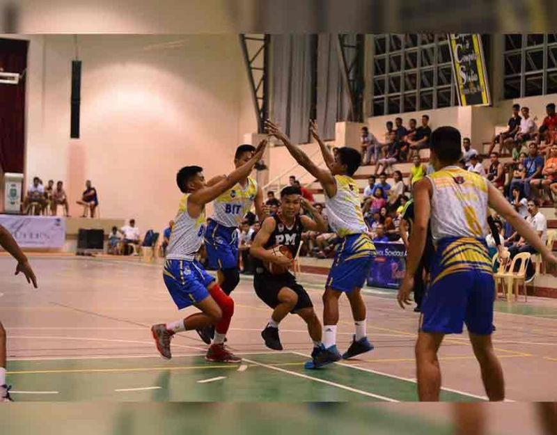 BOHOL. BIT IC's defense throws a triple-team against a player from PMI. (Contributed photo)