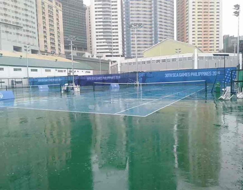 MANILA. Matches were not played as of 12 noon Tuesday at The Rizal Memorial Tennis Center due to the heavy rains brought about by Typhoon Tisoy that made landfall in the Philippines, leaving the courts wet and slippery. (Melchor Anzures)
