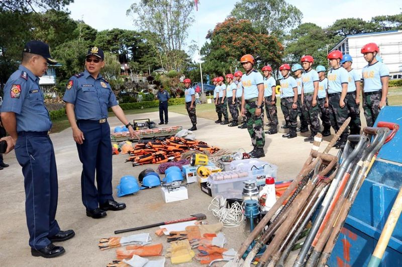 "BAGUIO. Police Regional Office–Cordillera (PRO-COR) director Police Brigadier General Israel Ephraim Dickson inspects the search and rescue(SAR) equipment to be used by the members of the SAR team of PROCOR for immediate deployment for the possible affects Typhoon ""Tisoy"" in Baguio City and Benguet Province. (Photo by RPIO-CAR)"