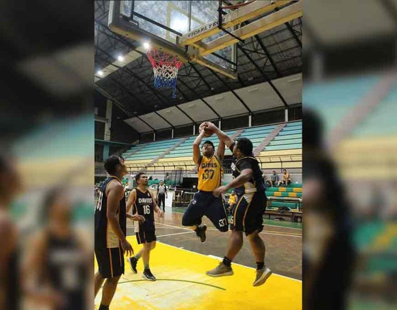 REJECTED. Alfred Calumba of Wall Arts blocks a shot from Powerfloor. (Contributed photo)