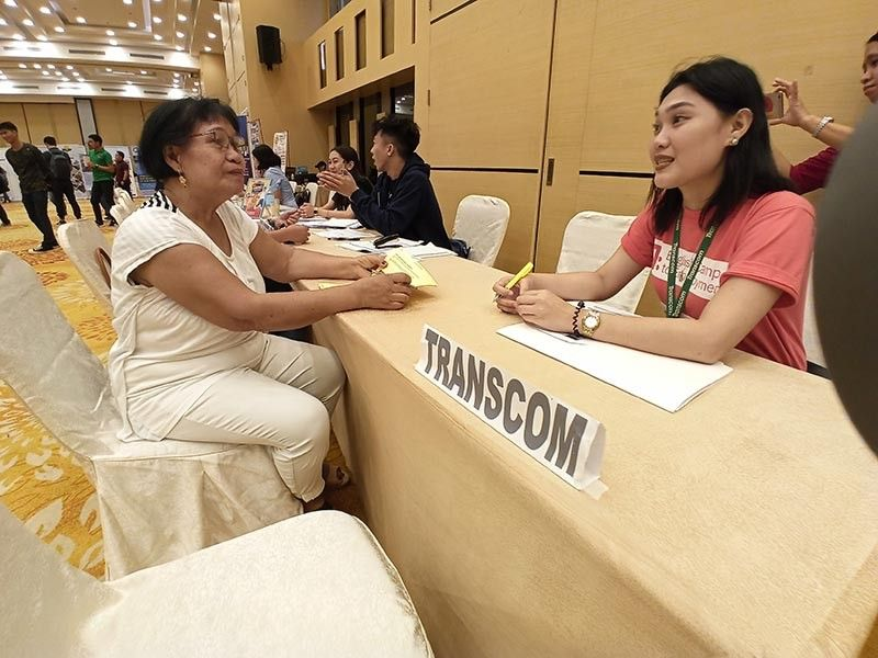 ILOILO. Senior Citizen Nieven Abangan talks to Joan Rosbero, Transcom recruitment officer, during the Iloilo Provincial Government Public Employment Service Office (Peso) job fair at Grand Xing Hotel on Wednesday, December 4, 2019. (Leo Solinap)