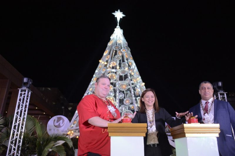 PAMPANGA. (Left to right) Clark Marriott General Manager Goeran Soelter, Widus Group Director Neki Liwanag, and Widus Hotel and Casino General Manager Tarek Aouini altogether light up a 45-foot Christmas Tree to officially welcome the Yuletide season. (Contributed Photo)