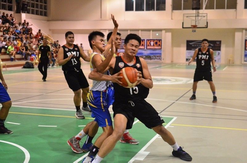 WINNER TAKE ALL. PMI's Regiren Campaner (with ball) tries to power his way to the ring in Game 2 of the Bohol Schools Athletic Association fianls.  PMI won, 85-55, to force a winner-take-all Game 3. (Contributed Photo )