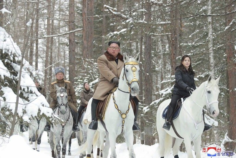 NORTH KOREA. This undated photo provided on Wednesday, December 4, 2019, by the North Korean government shows North Korean leader Kim Jong Un (center) with his wife Ri Sol Ju (right) riding on white horse during his visit to Mount Paektu, North Korea. North Korea said leader Kim has taken a second ride on a white horse to a sacred mountain in less than two months. Independent journalists were not given access to cover the event depicted in this image distributed by the North Korean government. The content of this image is as provided and cannot be independently verified. Korean language watermark on image as provided by source reads: