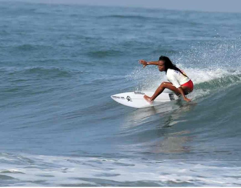 LA UNION. Daisy Valdez of the Philippines rides with the wave during the qualification round of the women's short board open category in the ongoing 30th Southeast Asian Games in San Juan, La Union. (Photo by Roderick Osis)
