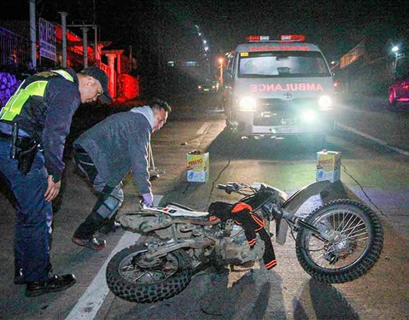 BAGUIO. The Emergency Response Service crew tends to one of the injured motorcycle riders during a vehicular road crash which transpired along Buhagan (Bokawkan) Road on September this year. (Photo by Jean Nicole Cortes)