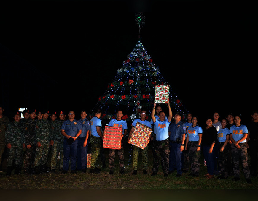 PAMPANGA. Personnel of the Angeles City Police Office rejoice after lighting the 20-foot Christmas tree on Wednesday, December 4, 2019. (Contributed photo)
