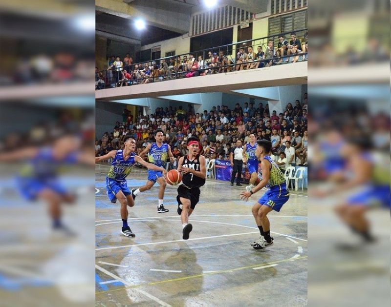 BOHOL.PMI's Joem Enguito punctures the defense of BIT IC in Game Three of the finals. (Contributed photo)