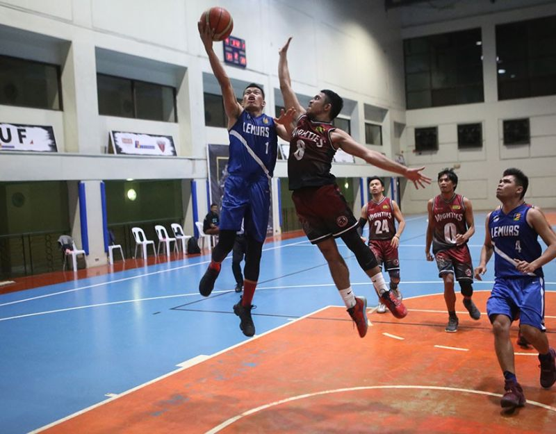 Contact Solutions' star Joey Juntilla flies high on this lay-up attempt. (Contributed Photo)