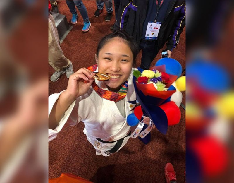 MANILA. Filipino-Japanese Mariya Takahashi, whose mother hails from Maragusan in Compostela Valley, smiles as she bites her gold medal that she won in the women's judo-70 kilograms during the 30th Southeast Asian (SEA) Games Friday, December 6, at the Laus Group Events Center in San Fernando, Pampanga. (Photo from Lynlyn Takahashi's Facebook)