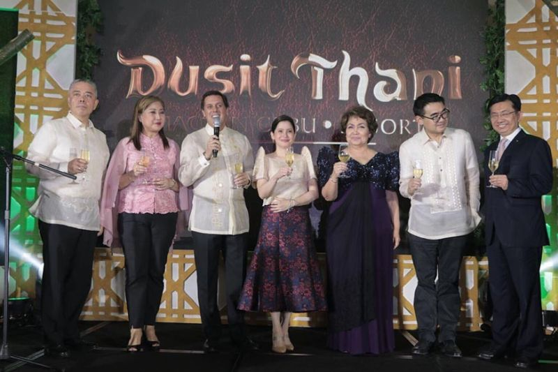 COMBINATION OF FILIPINO AND THAI HOSPITALITY AND GRACE. From left, Arthur Gindap, senior vice president and business unit general manager of Robinsons Hotels and Resorts; Ma. Cynthia King-Chan, first lady of Lapu-Lapu City; David Baldwin, general manager of Dusit Thani Mactan Cebu Resort; Tourism Secretary Bernadette Puyat; Lapu-Lapu City Rep. Paz Radaza; Frederick Go, chief executive officer of  Robinsons Land Corp.; and Lim Boon Kwee, chief operating officer of Dusit International, lead the ceremonial toast of the resort's official opening. (Contributed photo)