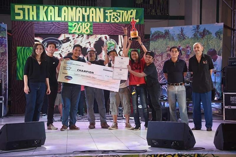 Last year's VMC Battle of the Bands winner - the Rockroad Band with their championship trophy and P30,000 in cash prize.