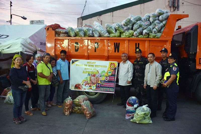 BAGUIO. La Trinidad officials, led by Mayor Romeo Salda, and League of Associations at the La Trinidad Vegetable Trading Post, led by president Nora Ganase, sent off more than five tons of assorted Benguet vegetables, non-food items and cash that were used to buy at least 28 cavans of rice that were donated to the disaster affected province of Apayao last week. (Redjie Melvic Cawis)