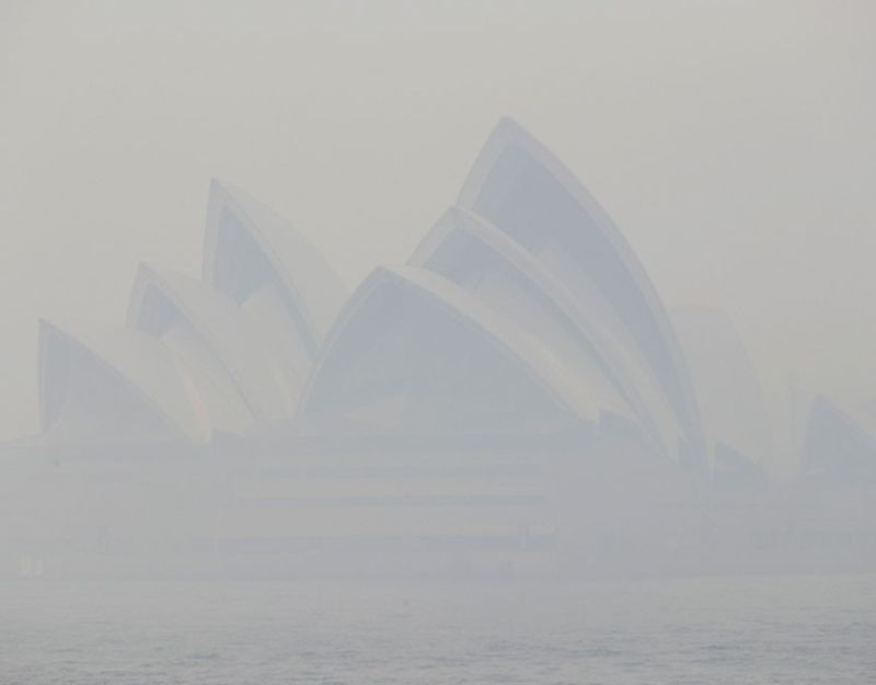 AUSTRALIA. Thick smoke from wildfires shroud the Opera House in Sydney, Australia, Tuesday, December 10. Hot dry conditions have brought an early start to the fire season. (AP)