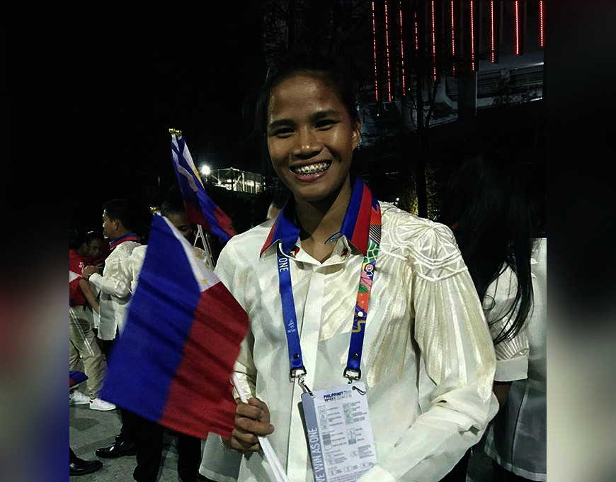 TARLAC. Toughest woman in athletics, Sarah Dequiñan of Valencia City, Bukidnon, claims the SEA Games gold in heptathlon event. (Contributed photo)