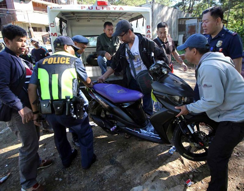 BAGUIO. Police officers led by Baguio City Police Office Director PCOL. Allen Ray Co impounds a motorcycle found along Suello Village which may have been used by the gunmen who assassinated a trader on December 9. (Photo by Jean Nicole Cortes)