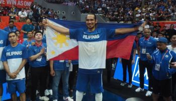 June Mar Fajardo raises the Philippine flag after leading the men's basketball to a gold medal finish at the Mall of Asia Arena. Fajardo and Greg Slaughter were the last Cebuano athletes to win a gold medal in the 30th Southeast Asian (SEA) Games. (SunStar foto/ Richiel S. Chavez)
