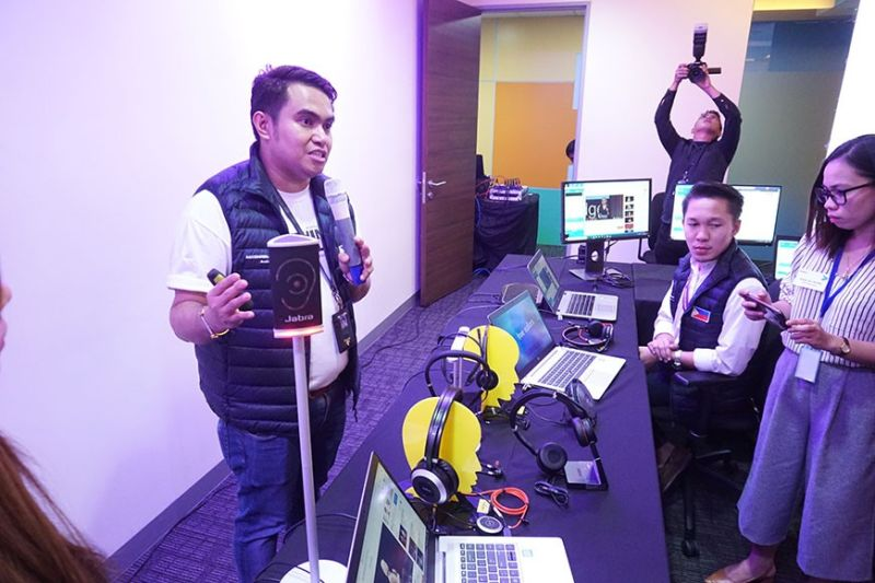 INCLUSIVE. An Accenture official shows some of their equipment for PWDs, including a special headset for the hearing- impaired. (Sunstar Photo /Alex Badayos)