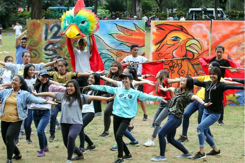 "BAGUIO. Senior high school students from the University of the Cordilleras rehearse at the Melvin Jones field in preparation for their school's ""Indakan"" Festival. (Photo by Jean Nicole Cortes)"