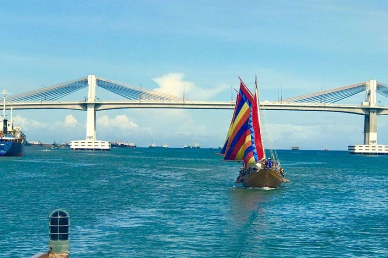 ANCIENT BOAT'S CLONE. Raya Siyagu, a replica of a pre-Spanish colonial era boat called balangay, navigates the Mactan Channel on Tuesday, Dec. 10, 2019. Raya Siyagu and the other balangay replica Raya Kolambu will grace the countdown to the Battle of Mactan's quincentennial celebration on Saturday, Dec. 14. (Contributed Photo)