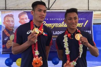 "BACOLOD. Fresh from winning the 30th Southeast Asian Games, Bagonhon boxing champions James Palicte and Rogen Ladon come home in Bago City Thursday, December 12, 2019. A heroes' welcome was prepared by the city government to honor the ""sports heroes"" serving as inspiration for Bagonhons especially young and aspiring boxers. (Photo by Erwin P. Nicavera)"