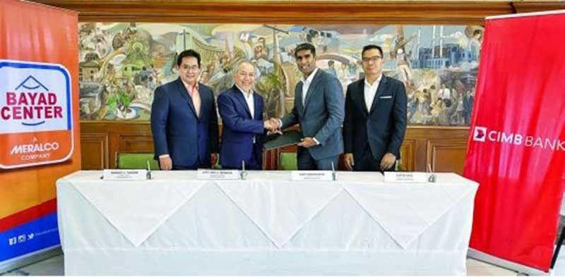 MANILA. From left, Manuel L. Tuason, president and CEO of CIS Bayad Center, Inc.; Ray Espinosa, Meralco president and CEO and Bayad Center chairman; Vijay Manoharan, CEO of CIMB Bank PH; and Lester Cruz, head of Consumer Marketing of CIMB Bank PH. (Contributed Photo)