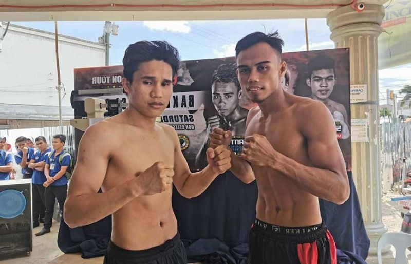 READY TO BATTLE. No.5 ranked superbantam weight Jeo Santisima (right) fights former regional champ Rene Dacquel in Bogo City. (Contributed photo)