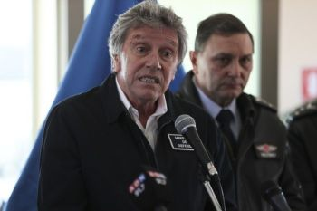 CHILE. Chile's Defense Minister Alberto Espina speaks during a news conference at the Chilean Air Force base in Punta Arenas, Chile on Thursday, December 12. Espina said human remains have been found from a military aircraft that disappeared on a flight to Antarctica. The plane was carrying 38 passengers when it took off from southernmost Chile on Monday, December 9. (AP)