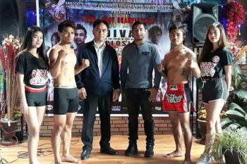 BAGUIO. Delfin Nawen, second from left and Mhel Clinton Remolar (second from right) in their face off for the main event of the Team Lakay Championship 12: Adivay Explosion tonight, December 14 at the Benguet Multi-Purpose Gym in Wangal, La Trinidad. Also in photo are Benguet Vice Governor Johnny Waguis and Brave CF bantamweight champion Stephen Loman. (Photo by Roderick Osis)