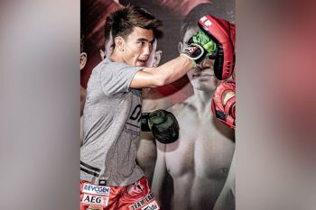 NO REST. Joshua Pacio immediately returns to action January next year to defend his ONE Championship strawweight title against former world champion Alex Silva at the Mall of Asia Arena. (ONE photo)