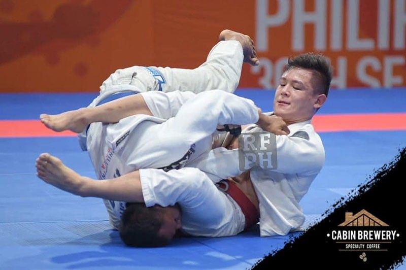 SILVER FINISH. Marc Alexander Lim of Davao City, top, wins a silver medal for Team Philippines in the recently-concluded 30th Southeast Asian (SEA) Games men's jiu jitsu competition at the Laus Group Events Center in San Fernando, Pampanga. (Real Fight Philippines)