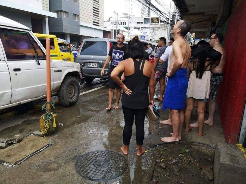 DAVAO. Residents of a high-rise condominium along CM Recto in Davao City evacuate their building after a magnitude 6.9 quake struck Davao del Sur. (Photo by Macky Lim)
