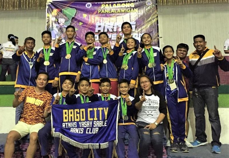 BACOLOD. Bago City arnis team in posterity after emerging as overall champions in the recently-concluded 2019 Palarong Panlalawigan arnis competition. (Contributed by Brian Martir)