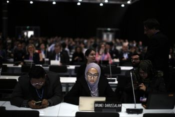 SPAIN. Participants take part at the COP25 climate talks congress in Madrid, Spain on Saturday, December 14. The United Nations Secretary-General has warned that failure to tackle global warming could result in economic disaster. (AP)