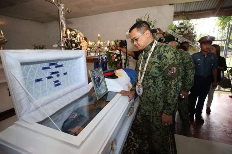 EASTERN SAMAR. Lieutenant General Archie Francisco Gamboa, officer-in-charge of the Philippine National Police, paid his last respects to Patrolman Mark Jerome Rama, who was killed in an ambush staged by suspected New People's Army rebels in Borongan City, Eastern Samar on December 13, 2019. (Photo courtesy of PNP)