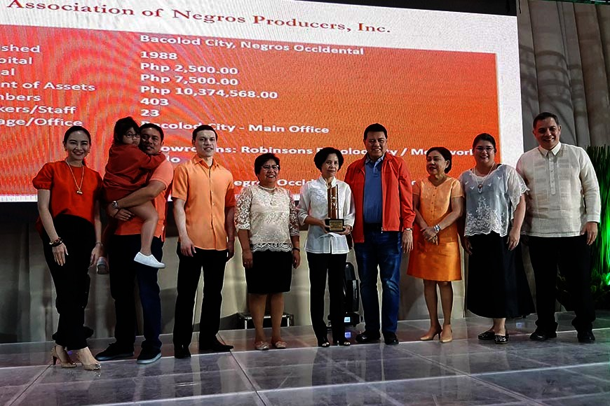 BACOLOD. The Association of Negros Producers led by its president Arlene Infante center) and chair Christina Gaston (second from right) receive the