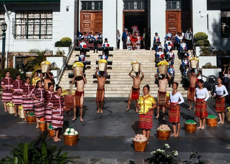 BAGUIO. Students perform during the launching of the 25th Panagbenga Festival on December 16 during the flag raising ceremony, highlighting the festival's blooming through the years. (Photo by Glenn Pat-ogan)