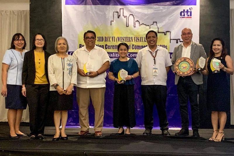 BACOLOD. Vice Mayor El Cid Familiaran (second from right), representing Mayor Evelio Leonardia, and Leipo (Local Economic and Investment Promotions Officer)-designate Jonah Javier (first from right) accept the trophies for Bacolod as the Most Competitive Highly Urbanized City in Economic Dynamism and Infrastructure, with (from left) National Economic and Development Authority-Western Visayas Economic Development Council focal person Roxanne Yap, Department of Trade and Industry-Western Visayas Director Rebecca Rascon, Iloilo City Planning and Development Office head Jose Roni Peñalosa, Iloilo City Disaster Risk Reduction and Management Office head Donna Magno, and Franco Agora of Iloilo CPDO. (Contributed photo)