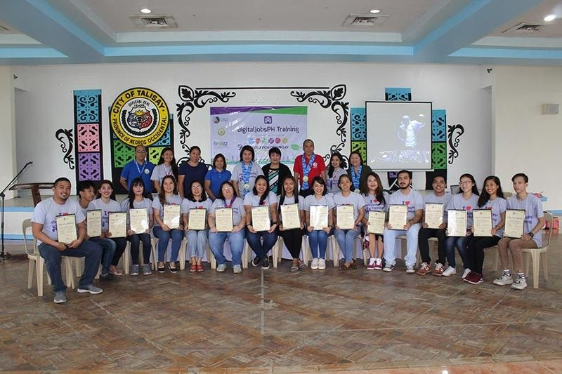 NEGROS. DICT-Negros Occidental Provincial Officer Romeo Tome (standing third from right) with Talisay City officials and graduates of the virtual assistance technical training in rites held at the City Hall Tuesday, December 17, 2019. (Contributed photo)