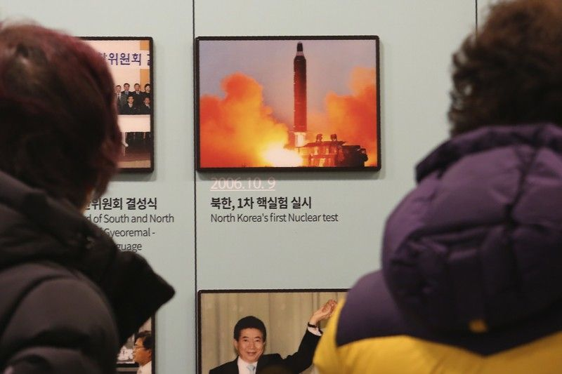 SOUTH KOREA. Visitors watch a photo showing North Korea's missile launch at the Unification Observation Post in Paju, South Korea, near the border with North Korea, Friday, Deember 13. North Korea accused the United States of