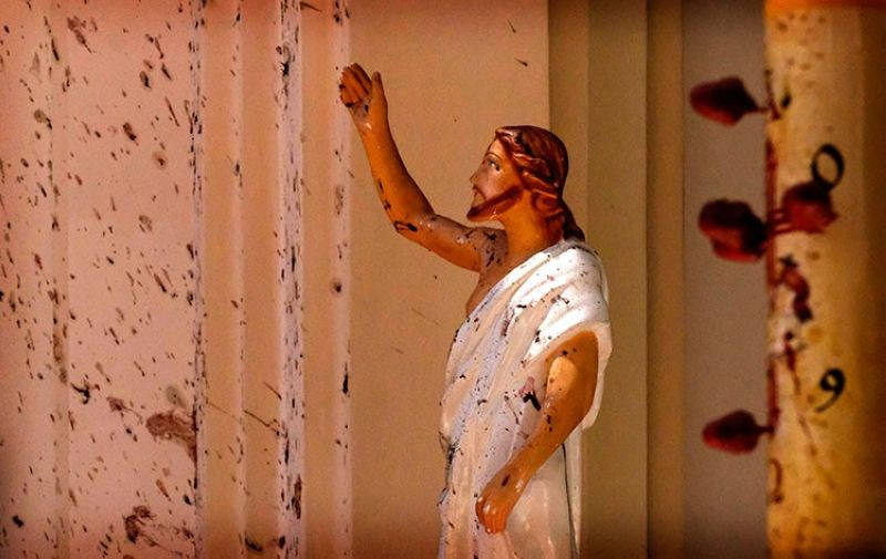 SRI LANKA. In this April 21, 2019, file photo, bloodstains are seen on a Jesus Christ statue at the St. Sebastian's Church after a blast in Negombo, north of Colombo, Sri Lanka. On Easter Sunday, April 21, bombs shattered the celebratory services at two Catholic churches and a Protestant church in Sri Lanka. (AP)