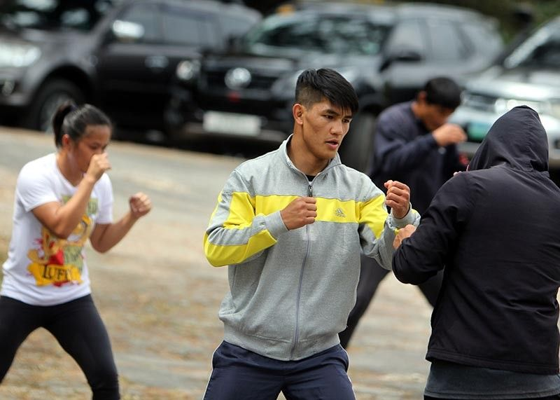 MANILA. Danny Kingad is joined in the background by Gina Iniong and Eduard Folyang as they gear up for ONE Championship's Fire & Fury at the Mall of Asia Arena January 31. (Photo by Roderick Osis)