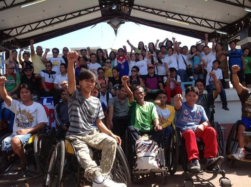 Members of the Association of Differently-Abled Persons, Inc., (Adap) blind and deaf associations, Muslims with disabilities, parents and advocates at the Rizal Park. (Photo from Adap Facebook)