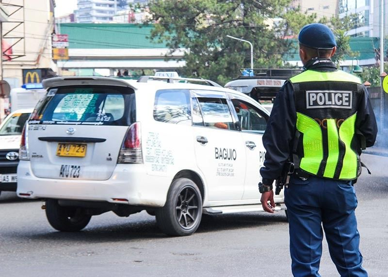 BAGUIO. Traffic enforcers are on alert this holiday season due to the influx of tourists as congestion of vehicles is expected to get worse with the long holiday. (Photo by Jean Nicole Cortes)